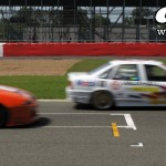 Silverstone Classic: BTCC Vauxhall Cavalier dices with Mazda 323F